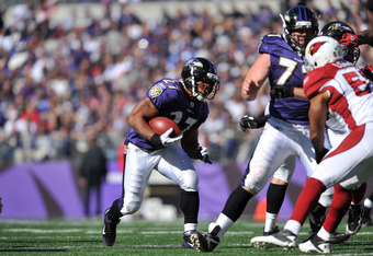 BALTIMORE - OCTOBER 30:  Ray Rice #27 of the Baltimore Ravens runs the ball against the Arizona Cardinals at M&T Bank Stadium on October 30. 2011 in Baltimore, Maryland. The Cardinals lead the Ravens 24-6 at the half. (Photo by Larry French/Getty Images)