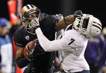 Wide receiver james Johnson stiff arms Arizona's Cortez Johnson