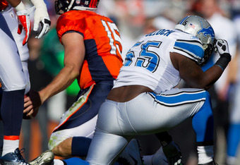 Linbacker Stephen Tulloch does the 'Tebow' after sacking the Broncos' QB
