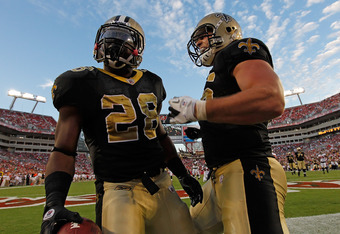 TAMPA, FL - OCTOBER 16:  Running back Mark Ingram #28 of the New Orleans Saints celebrates his touchdown with fullback Jed Collins #45 during the game against the Tampa Bay Buccaneers at Raymond James Stadium on October 16, 2011 in Tampa, Florida.  (Photo