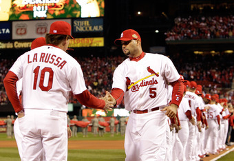 ST LOUIS, MO - OCTOBER 19:  Albert Pujols #5 and manager Tony La Russa #10 of the St. Louis Cardinals greet each other during introductions prior to Game One of the MLB World Series against the Texas Rangers at Busch Stadium on October 19, 2011 in St Loui