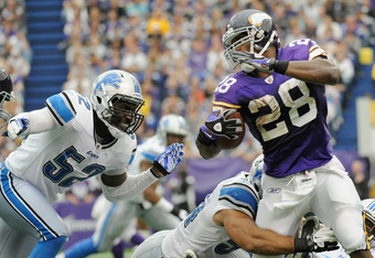 MINNEAPOLIS, MN - SEPTEMBER 25: Justin Durant #52 and DeAndre Levy #54 of the Detroit Lions looks to tackle Adrian Peterson #28 of the Minnesota Vikings in the fourth quarter on September 25, 2011 at Hubert H. Humphrey Metrodome in Minneapolis, Minnesota.