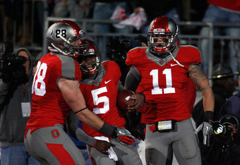 COLUMBUS, OH - OCTOBER 29:  Braxton Miller #5 of the Ohio State Buckeyes is congratulated by teammates Reid Fragel #88 and Jake Stoneburner #11 after scoring against the Wisconsin Badgers during the fourth quarter on October 29, 2011 at Ohio Stadium in Co