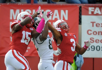 LINCOLN, NE - OCTOBER 29: Safety Daimion Stafford #3 of the Nebraska Cornhuskers and cornerback Alfonzo Dennard #15 of the Nebraska Cornhuskers knock a pass away from wide receiver Keshawn Martin #82 of the Michigan State Spartans during their game at Mem
