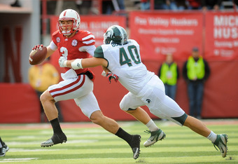 LINCOLN, NE - OCTOBER 29: Quarterback Taylor Martinez #3 of the Nebraska Cornhuskers tries to slip past linebacker Max Bullough #40 of the Michigan State Spartans during their game at Memorial Stadium October 29, 2011 in Lincoln, Nebraska. (Photo by Eric