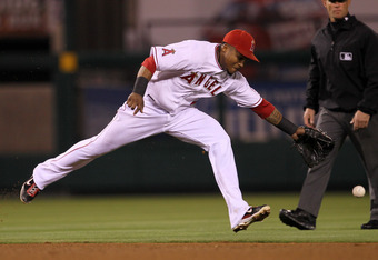 ANAHEIM, CA - SEPTEMBER 24:  Shortstop Erick Aybar #2 of the Los Angeles Angels of Anaheim can't reach a leadoff single hit by Scott Sizemore of the Oakland Athletics in the fifth inning on September 24, 2011 at Angel Stadium in Anaheim, California.   (Ph