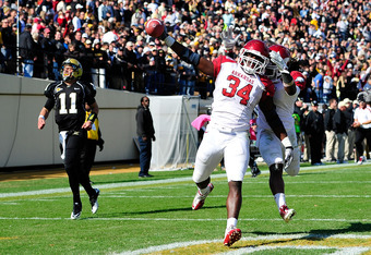 NASHVILLE, TN - OCTOBER 29:  Jerry Franklin #34 of the Arkansas Razorbacks returns a fumble for a touchdown as quarterback Jordan Rogers #11 of the Vanderbilt Commodores looks on during play at Vanderbilt Stadium on October 29, 2011 in Nashville, Tennesse