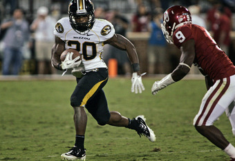 NORMAN, OK - SEPTEMBER 24:  Tail back Henry Josey #20 of the Missouri Tigers rushes up field during the second half against the Oklahoma Sooners on September 24, 2011 at Gaylord Family-Oklahoma Memorial Stadium in Norman, Oklahoma.  Oklahoma defeated Miss