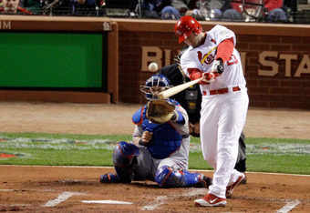 ST LOUIS, MO - OCTOBER 28: David Freese #23 of the St. Louis Cardinals hits a two-run double in the first inning during Game Seven of the MLB World Series against the Texas Rangers at Busch Stadium on October 28, 2011 in St Louis, Missouri.  (Photo by Rob