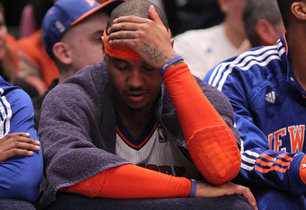 NEW YORK, NY - APRIL 22:  Carmelo Anthony #7 of the New York Knicks sits on the bench dejected late in the second half against the Boston Celtics in Game Three of the Eastern Conference Quarterfinals in the 2011 NBA Playoffs on April 22, 2011 at Madison S