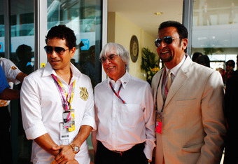 NOIDA, INDIA - OCTOBER 30:  F1 supremo Bernie Ecclestone (C) is seen with cricketer Sachin Tendulkar (L) and Bollywood actor Gulshan Grover (R) before the Indian Formula One Grand Prix at the Buddh International Circuit on October 30, 2011 in Noida, India