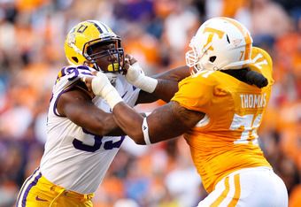 KNOXVILLE, TN - OCTOBER 15:  Sam Montgomery #99 of the LSU Tigers against Dallas Thomas #71 of the Tennessee Volunteers at Neyland Stadium on October 15, 2011 in Knoxville, Tennessee.  (Photo by Kevin C. Cox/Getty Images)