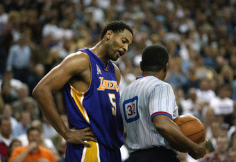 SACRAMENTO, CA - MAY 20: Robert Horry #5 of the Los Angeles Lakers talks to Referee Eddie F. Rush in Game two of the Western Conference Finals against the Sacramento Kings during the 2002 NBA Playoffs at Arco Arena in Sacramento, California on May 20, 200