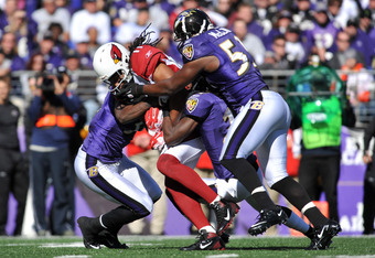 BALTIMORE - OCTOBER 30:  Larry Fitzgerald #11 of the Arizona Cardinals makes a catch against the Baltimore Ravens at M&T Bank Stadium on October 30. 2011 in Baltimore, Maryland. The Ravens defeated the Cardinals 30-27. (Photo by Larry French/Getty Images)