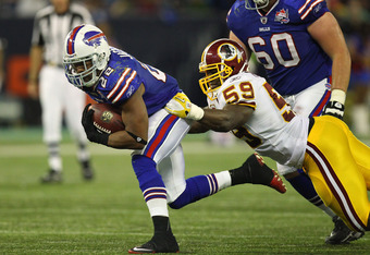 TORONTO, ON - OCTOBER 30: Fred Jackson #14 of the Buffalo Bills carries for a gain during NFL game action as London Fletcher #59 of the Washington Redskins tackles him at Rogers Centre on October 30, 2011 in Toronto, Ontario, Canada. (Photo by Tom Szczerb