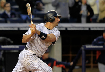 NEW YORK, NY - OCTOBER 02:  Jorge Posada #20 of the New York Yankees hits a triple in the ninth inning against the Detroit Tigers during Game Two of the American League Division Series at Yankee Stadium on October 2, 2011 in New York City.  (Photo by Chri