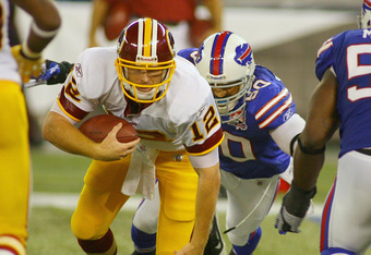 TORONTO, ON - OCTOBER 30: John Beck #12 of the Washington Redskins is sacked by Nick Barnett #50 of the Buffalo Bills at Rogers Centre on October 30, 2011 in Toronto, Ontario, Canada. Buffalo won 23-0.  (Photo by Rick Stewart/Getty Images)