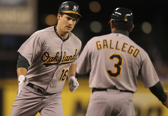 SEATTLE - SEPTEMBER 27:  Josh Willingham #16 of the Oakland Athletics is congratulated by third base coach Mike Gallego #3 after hitting a three-run homer in the first inning against the Seattle Mariners at Safeco Field on September 27, 2011 in Seattle, W