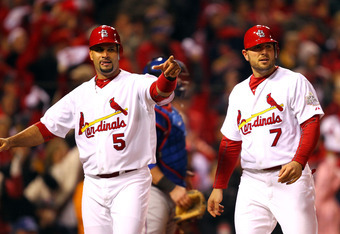 ST LOUIS, MO - OCTOBER 19:  (L-R) Albert Pujols #5 and Matt Holliday #7 of the St. Louis Cardinals celebrate after scoring on a two-RBI single in the bottom of the fourth inning by Lance Berkman #12 (not shown) during Game One of the MLB World Series agai