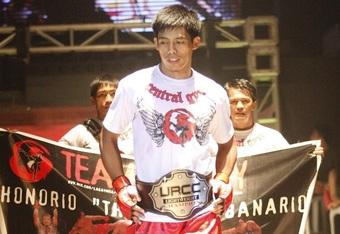 Unbeaten URCC Lightweight Champion Honorio Banario enters the ring