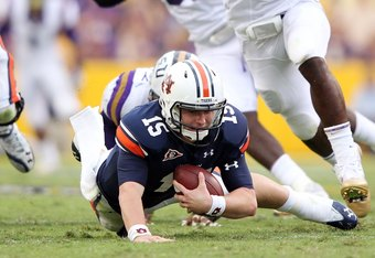 BATON ROUGE, LA - OCTOBER 22:  Quarterback Clint Moseley #15 of the Auburn Tigers is sacked by Sam Montgomery #99 of the LSU Tigers during the game at Tiger Stadium on October 22, 2011 in Baton Rouge, Louisiana.  (Photo by Jamie Squire/Getty Images)