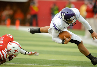 LINCOLN, NE - NOVEMBER 5: Quarterback Kain Colter #2 of the Northwestern Wildcats is tripped up by defensive back Lance Thorell #23 of the Nebraska Cornhuskers during their game at Memorial Stadium November 5, 2011 in Lincoln, Nebraska.  Northwestern beat