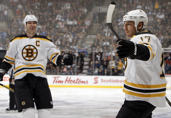 TORONTO, CANADA - NOVEMBER 5: Zdeno Chara #33 and Milan Lucic #17 of the Boston Bruins celebrate a goal against the Toronto Maple Leafs during NHL action at The Air Canada Centre November 5, 2011 in Toronto, Ontario, Canada. (Photo by Abelimages/Getty Ima