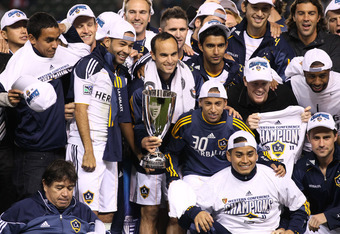 CARSON, CA - NOVEMBER 06:  Landon Donovan #10 of the Los Angeles Galaxy holds the Western Conference trophy surrounded by teammates after playing Real Salt Lake in the MLS Western Conference Championship at The Home Depot Center on November 6, 2011 in Car
