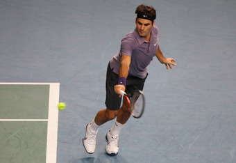 PARIS - NOVEMBER 11: Roger Federer of Switzerland in action against Radek Stepanek of the Czech Republic during Day Five of the ATP Masters Series Paris at the Palais Omnisports on November 11, 2010 in Paris, France.  (Photo by Michael Steele/Getty Images