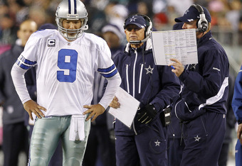 PHILADELPHIA, PA - OCTOBER 30: Tony Romo #9 the Dallas Cowboys gets a play from head coach Jason Garrett, right, during a game against the Philadelphia Eagles at Lincoln Financial Field on October 30, 2011 in Philadelphia, Pennsylvania. The Eagles defeate