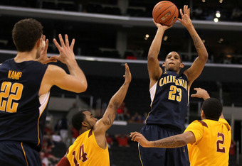LOS ANGELES, CA - MARCH 10:  Allen Crabbe #23 of the California Golden Bears shoots over Donte Smith #14 and Jio Fontan #2 of the USC Trojans in the second half in the quarterfinals of the 2011 Pacific Life Pac-10 Men's Basketball Tournament at Staples Ce
