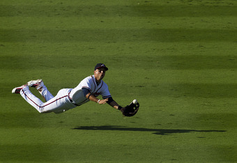 ATLANTA, GA - SEPTEMBER 17: Martin Prado #14 of the Atlanta Braves barely misses a diving catch in the sixth inning of the game against the New York Mets at Turner Field on September 17, 2011 in Atlanta, Georgia. (Photo by Daniel Shirey/Getty Images)