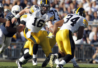 STATE COLLEGE, PA - OCTOBER 8:  James Vandenberg #16 of the Iowa Hawkeyes hands the ball off to Marcus Coker #34 against the Penn State Nittany Lions during the game on October 8, 2011 at Beaver Stadium in State College, Pennsylvania.  (Photo by Justin K.