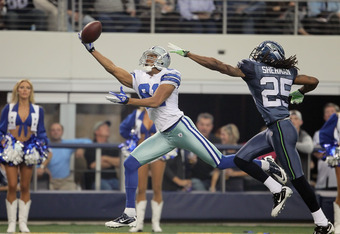 ARLINGTON, TX - NOVEMBER 06:  Wide receiver Laurent Robinson #81 of the Dallas Cowboys lunges but can't make a catch while being pursued by Richard Sherman #25 of the Seattle Seahawks in the second half at Cowboys Stadium on November 6, 2011 in Arlington,