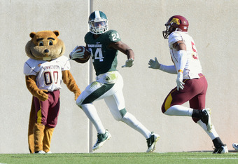 EAST LANSING, MI - NOVEMBER 05:  Le'Veon Bell #24 of the Michigan State Spartans rushes with the football while pursued by Aaron Hill #57 of the Minnesota Golden Gophers on a play in the third quarter of the game at Spartan Stadium on November 5, 2011 in