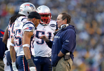 PITTSBURGH, PA - OCTOBER 30:  Head coach Bill Belichick of the New England Patriots talks to Jerod Mayo #51, Patrick Chung #25 and Brandon Spikes #55 at Heinz Field on October 30, 2011 in Pittsburgh, Pennsylvania.  (Photo by Gregory Shamus/Getty Images)