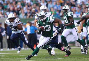 EAST RUTHERFORD, NJ - OCTOBER 23:  Shonn Greene #23 of the New York Jets rushes against the San Diego Chargers at MetLife Stadium on October 23, 2011 in East Rutherford, New Jersey.  (Photo by Nick Laham/Getty Images)