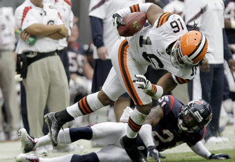 HOUSTON, TX - NOVEMBER 06: Wide receiver Josh Cribbs #16 of the Cleveland Browns breaks the tackle of cornerback Brice McCain #21 of the Houston Texans on November 6, 2011 at Reliant Stadium in Houston, Texas. (Photo by Thomas B. Shea/Getty Images)