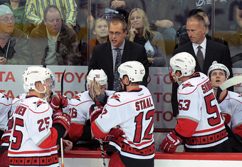 WINNIPEG, CANADA - OCTOBER 22: Head coach Paul Maurice of the Carolina Hurricanes speaks to his team on the bench in a game against the Winnipeg Jets in NHL action at the MTS Centre on October 22, 2011 in Winnipeg, Manitoba, Canada. The Jets won 5-3. (Pho