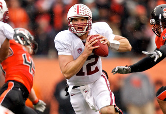 CORVALLIS, OR - NOVEMBER 5: Quarterback Andrew Luck #12 of the Stanford Cardinal rushes past defensive tackle Andrew Seumalo #49 of the Oregon State Beavers on November 5, 2011 at Reser Stadium in Corvallis, Oregon. Stanford won the game 38-13. (Photo by