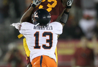 LOS ANGELES, CA - SEPTEMBER 11:  Wide receiver Ronald Johnson #83 of the USC Trojans reaches for the ball over cornerback Chase Minnifield #13 of the Virginia Cavaliers at Los Angeles Memorial Coliseum on September 11, 2010 in Los Angeles, California. USC