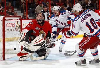 OTTAWA, CANADA - NOVEMBER 9: Marian Gaborik #10 of the New York Rangers scores a third period goal against Craig Anderson #41 of the Ottawa Senators as Derek Stepan #21 of the New York Rangers looks on during an NHL game at Scotiabank Place on November 9,