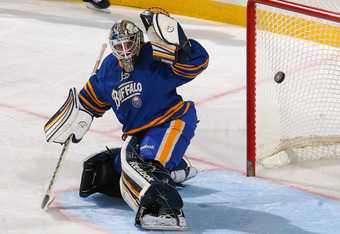 BUFFALO, NY - OCTOBER 27: Jhonas Enroth #1 of the Buffalo Sabres deflects the puch with his glove against the Columbus Blue Jackets at First Niagara Center on October 27, 2011 in Buffalo, New York.  (Photo by Rick Stewart/Getty Images)