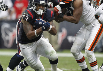HOUSTON - NOVEMBER 06:  Running back Arian Foster #23 of the Houston Texans rushes against the Clevland Browns at Reliant Stadium on November 6, 2011 in Houston, Texas.  (Photo by Bob Levey/Getty Images)
