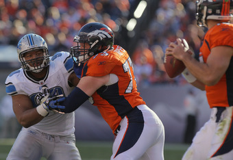 DENVER, CO - OCTOBER 30:  Defensive tackle Ndamukong Suh #90 of the Detroit Lions battles against the block of offensive guard Chris Kuper #73 of the Denver Broncos Sports Authority at Invesco Field at Mile High on October 30, 2011 in Denver, Colorado.  (