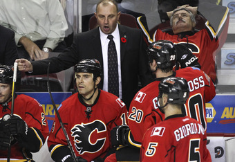 CALGARY, CANADA - NOVEMBER 8: Coach Brent Sutter of the Calgary Flames tries to rally his players near the end of a 2 - 0 loss to the Minnesota Wild in NHL action on November 8, 2011 at the Scotiabank Saddledome in Calgary, Alberta, Canada. (Photo by Mike