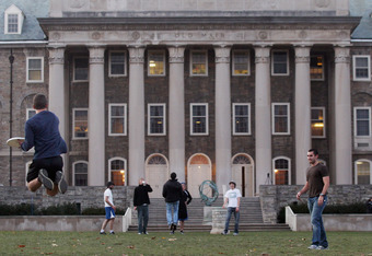STATE COLLEGE, PA - NOVEMBER 11:  Penn State students play frisbee in front of Old Main on campus in the wake of the Jerry Sandusky scandal on November 11, 2011 in State College, Pennsylvania. Head football coach Joe Paterno was fired amid allegations tha