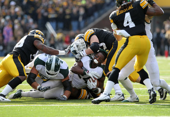 IOWA CITY, IA - NOVEMBER 12:  Le'Veon Bell #24 of the Michigan State Spartans is tackled by the Iowa Hawkeyes at Kinnick Stadium November 12, 2011 in Iowa City, Iowa.  (Photo by Reese Strickland/Getty Images)