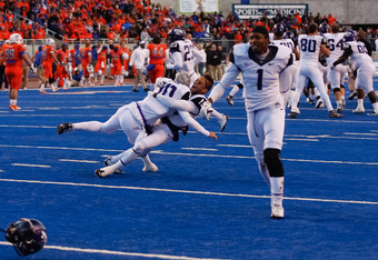 BOISE, ID - NOVEMBER 12: Matt Brown #10, Travaras Battle #18, and Tekerrein Cuba #1 of the TCU Horned Frogs celebrate after the win against the Boise State Broncos at Bronco Stadium on November 12, 2011 in Boise, Idaho.  (Photo by Otto Kitsinger III/Getty