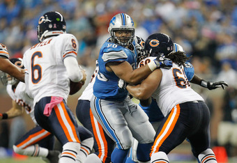 DETROIT, MI - OCTOBER 10:  Ndamukong Suh #90 of the Detroit Lions tries to get around the block of Lance Louis #60 of the Chicago Bears to get to Jay Cutler #6 at Ford Field on October 10, 2011 in Detroit, Michigan. Detroit won the game 24-13.  (Photo by